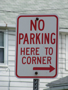 No Parking Here to Corner ---->